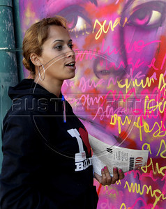Artist Panmela Castro paints on the wall of Fundicao Progresso, Rio de Janeiro, Brazil, August 5, 2011. (Austral Foto/Renzo Gostoli)