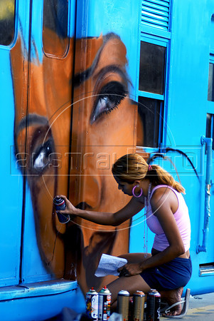 Brazilian popular artist Panmela Castro, 26, paints a train at Engenho de Dentro station, Rio de Janeiro, Brazil, Nov. 3, 2007. More than 20 street artists participated in the event, sponsored the Supervia commuter railroad and by non-governmental organizations that work with social assistance for youths from slums and poor communities. (Austral Foto/Renzo Gostoli)