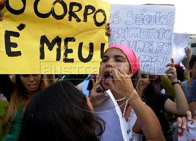 "Women participates at the ""Marcha das vadias"", inspirated by the Slut Walk, a march against sexism and in favor of women's rights wich started in Canada and has been spreading all around the world, at the Copacabana beach, Rio de Janeiro, Brazil, July 2, 2011. Women at the ""Marcha das vadias"" in Rio complain about the high rates of violence against women in Brazil. (Austral Foto/Renzo Gostoli)"