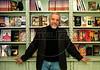 """Brazilian writer Paulo Coelho, author of """"O Alquimista"""" (The Alchemist), (1988), """"O Diário de um Mago"""" (The Pilgrimage), (1987), """"A Bruxa de Portobello"""" (The witch of Portobello), (2006) and many others books, poses at his office in Copacabana, Rio de Janeiro, Brazil, 1996. (Austral Foto/Renzo Gostoli)"""
