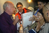 Uruguayan writer Eduardo Galeano, left, signs autographs after a press conference at the World Social Forum in Porto Alegre, Brazil, Jan. 29, 2005. The eclectic gathering of pacifists, environmentalists, libertarians, trade unionists and anti-establishment militants was timed to coincide with its nemesis, the World Economic Forum held thousands of kilometers (miles) away in the swank Swiss mountain resort of Davos. (Douglas Engle/Australfoto)