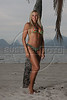 Brazilian model Angela Bismarchi poses on a beach of Niteroi, with a view of Rio de Janeiro behind her.  Bismarchi who became famous for parading in Rio's carnival with nothing on except a Brazilian flag painted on her,  is also known for her many plastic surgeries - more than 40 according to some sources. (Australfoto/Douglas Engle)