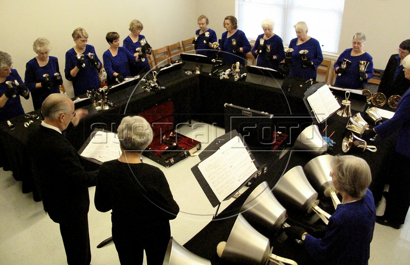 Members of the Blue Ridge Ridge Ringers handbell group rehearse at the First United Methodist Church in Hendersonville, NC, Nov. 3, 2008. Handbells started in England as a way to practice ringing for tower bells, but soon became a separate style. Most people are pleasantly suprised at the smooth and mellow sound they make and also the precise coordination required to play them.(Australfoto/Douglas Engle)