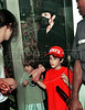 "Pop star Michael Jackson visits a Ipanema's shopping center, Rio de Janeiro, Brazil, Feb. 12, 1996. Michael Jackson is in Rio de Janeiro for the filming of the video for his song ""They Don't Care About Us.""  (Austral Foto/Renzo Gostoli)"
