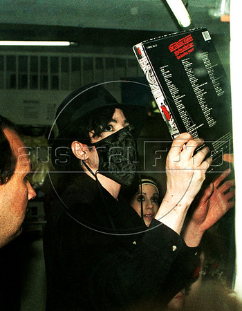 """Pop star Michael Jackson looks at a Rolling Stones album in a Ipanema's shopping center, Rio de Janeiro, Brazil, Feb. 12, 1996. Michael Jackson is in Rio de Janeiro for the filming of the video for his song """"They Don't Care About Us.""""  (Austral Foto/Renzo Gostoli)"""