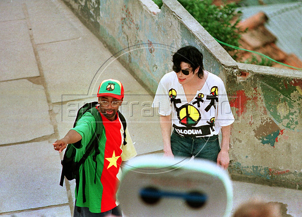 "Pop star Michael Jackson, right, speaks with American film directorand producer Spike Lee, left, on the roof of a building in the Dona Marta slum, Rio de Janeiro, Brazil, Feb. 11, 1996 during the filming of the video for his song ""They Don't Care About Us.""  (Austral Foto/Renzo Gostoli)"