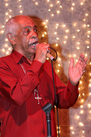 Walter Nunes de Abreu, better known as Walter Alfaiate, sings at a club in the Lapa district of Rio de Janeiro, Jan. 14, 2006. Born June 7, 1930, Alfaiate, whose career spans more than 50 years, only became famous in the 1980s when younger musicians began recording his songs. He has more than 200 samba songs to his credit. Once a forgotten part of the city near downtown, Lapa, samba music and show houses are experiencing a renaissance uncommmon to Brazil, which does not tend to value anything old.(Australfoto/Douglas Engle)