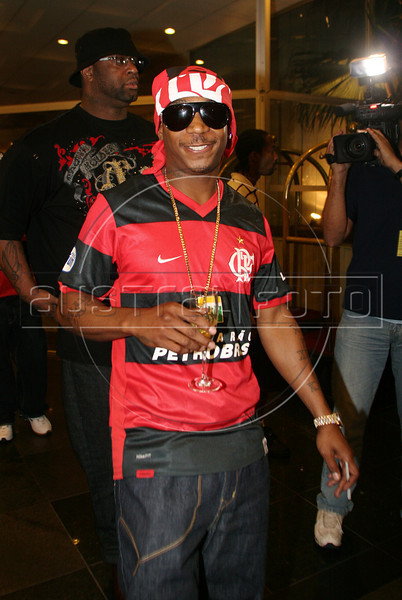The American rapper Ja Rule, left, wearing a tee-shirt of Flamengo team, assists at the classic match between Vasco da Gama and Flamengo teams at Maracana stadium for the Brazil's championship, Rio de Janeiro, Brazil, July 13, 2008. (Austral Foto/Gabriela Andrade)