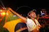 A Rolling Stones fan waves a Brazilian flag during the show in Rio de Janeiro, Feb. 18, 2006.(AustralFoto/Douglas Engle)