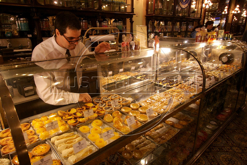 A worker arranges pastries at the historic Colombo restaurant and pastry shop in downtown in Rio de Janeiro, Brazil, June 23, 2008. Since its founding in 1894, the restaurant has received dignitaries throughout the decades including England's Queen Elizabeth, Belgium's King Albert, as well as almost every Brazilian President. (Australfoto/Douglas Engle)