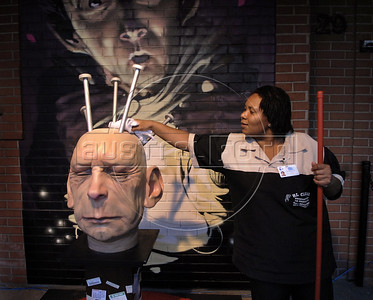 A handmaid cleans a statue exposed in a street art gallery as part of ArtRio, International Contemporary Art Fair of Rio de Janeiro, Rio de Janeiro, Brazil, September 7, 2011. (Austral Foto/Renzo Gostoli)