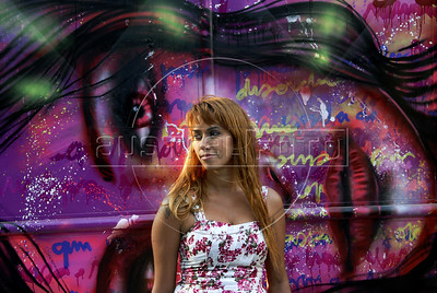 Artist Panmela Castro stay in front of her graffiti  painted on the wall of a house in Rio's Gamboa district as part of ArtRio, International Contemporary Art Fair of Rio de Janeiro, Rio de Janeiro, Brazil, September 7, 2011. (Austral Foto/Renzo Gostoli)