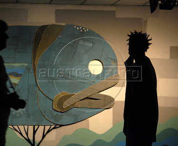A visitor looks at work of graffiti artist exposed in a street art gallery as part of ArtRio, International Contemporary Art Fair of Rio de Janeiro, Rio de Janeiro, Brazil, September 7, 2011. (Austral Foto/Renzo Gostoli)