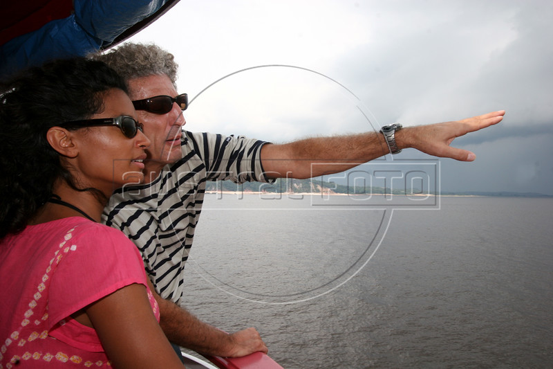 French director Elie Chouraqui, right, and Isabel Suplicy look at the Amazon River during a tour in Manaus, Capital of the Brazilian state of Amazonas, Nov. 6, 2005. Chouraqui is part of the jury of The World Adventure Film Festival, billed as dedicated to the human spirit of adventure, from Nov. 4 through 10, 2005. The festival was launched last year by the government of the State of Amazon to highlight its role of preserving natural heritage. (AustralFoto/Douglas Engle)