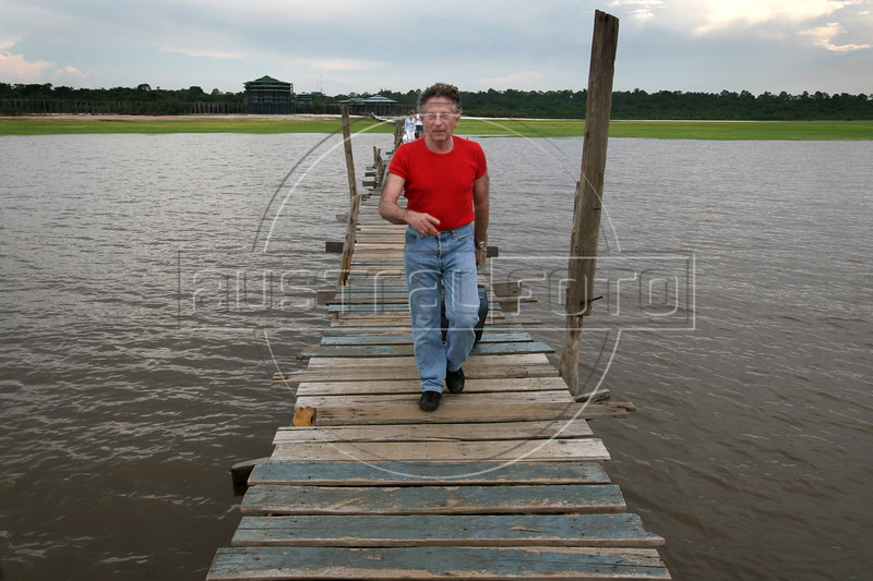French director Roman Polanski walks on a pier towards a boat watches a regional folklore show during The World Adventure Film Festival, in Manaus, Capital of the Brazilian state of Amazonas, Nov. 7, 2005. The festival, billed as dedicated to the human spirit of adventure, was launched last year by the government of the State of Amazon to highlight its role of preserving natural heritage. (AustralFoto/Douglas Engle)