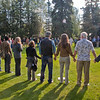 Attendees form a large circle to share a moment of thanks before brunch.