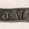 Artist's stamped initials.