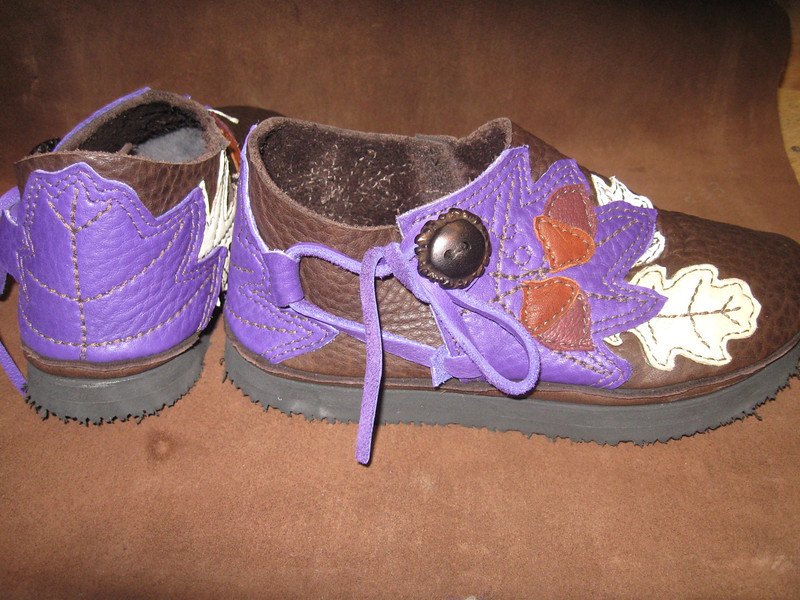 Another view of Pam's beautiful new moccasins.  This time we show the leaf heel and the leaf button trim.