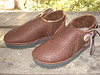 Chocolate Buffalo One Button Moccasins; Chocolate Natural Edge Button Trim; Natural Antler Sidecuts; Thick Cushi Midsole, Spikeless Golf Vibram Soling.