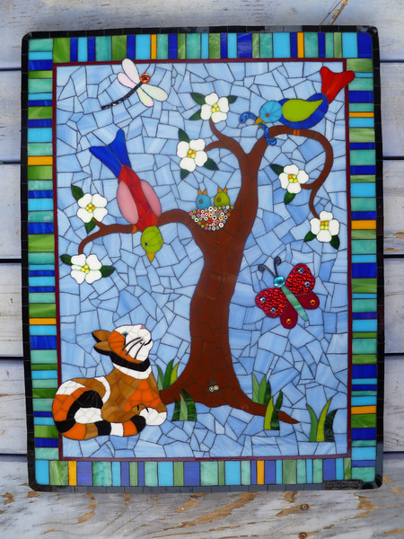"Commission.  Papa bird is keeping an eye on the kitty while mama bird feeds the babies.  Approx. 19""X25""  Stained glass, beads, millefiore, mirror, wire."