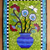 "Commission.  Approx. 24""X30""  Stained glass, ceramic tiles, beads.  Based on quilt style."