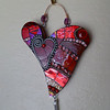 """My Funky Valentine""  Approx. 6""X7""  Made on leftover MDF.  Stained glass, wire, millefiore, ceramic, ball chain."