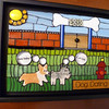 """Dog Dating""   6-1/2"" X 8-1/2""  Typical story:  dog meets dog, dog sniffs dog's butt, dog loses dog.  Stained glass, beads, millefiore, wire, printed text, ceramic dog tiles by Mary Dixon (etsy)."