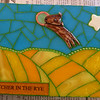 """Catcher in the Rye""  6-1/2"" X 8-1/2""   Stained glass, ball chain, ceramic dog tile by Mary Dixon."