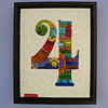"""Another Fab Four""  12-3/4"" X 15-3/4""  Obviously not as fab as the original, but inspired by the nickname.  Stained glass, beads, ceramic tiles, wire, mirror, millefiore, ball chain."