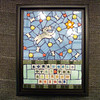 """""""Doggy Heaven"""" or """"Somewhere Over the Rainbow Bridge"""".  6-1/2""""X 8-1/2""""  Tennis balls, snacks, and lots of love in heaven.  Stained glass, ceramic tiles, beads.  Dog tile and letters by Mary Dixon (etsy)."""