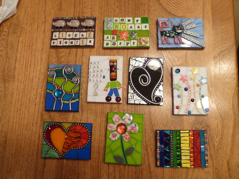 A batch of artist trading cards.  Very relaxing to make after doing a large, complex mosaic.  Ceramic animal tiles and ceramic letters made by Mary Dixon (etsy).