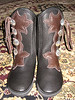 "These boots are living on Sue's happy feet!  She is an activist from the feet up!  See  <a href=""http://www.chico-peace.org"">http://www.chico-peace.org</a>.<br /> Four Button Black Buffalo Moccasins, Chocolate Extreme Flower Button Trim, Black Deerskin Full Welt, Silver QuickSilver Buttons, NewFlex Vibram Soling."