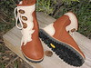 These wonderful hiking boots live on the feet of Sissa, a woman who understands the importance of quality footwear and good music!  We get together annually at the Kate Wolf Music Festival.  You will see Sissa's shoe designs in several of the galleries. <br /> Three Button Tobacco Buffalo Outside Seam Moccasin, Creme Flower Button Trim, Burnt Cork Deerskin Top Welt, Medium Dye Antler Crown Buttons, Kletterlift Vibram Soling