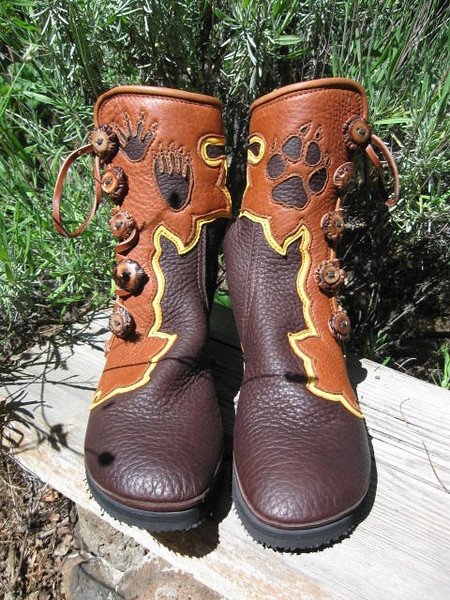 Bishop's amazing walkin' boots... ready for anything!<br /> Chocolate Buffalo Hide, Tobacco Extreme Flower Button Trim, Gold Deerskin Underlay, Burnt Cork Deerskin Full Welt with Dome to side, Insets of animal prints, with Antler Crown Buttons, Thin Cushi Midsole, with Spikeless Golf Vibram soling.