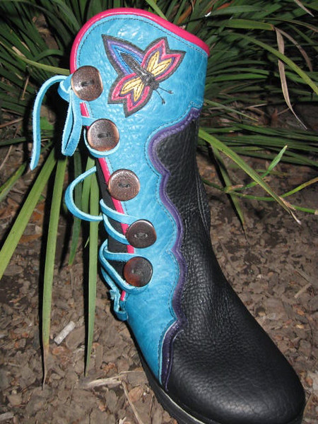 Fun boots for a fun person!  Black buffalo hide five button moccasins, with a turquoise button trim in the points and curves pattern going around the leg, purple deerskin underlay, dragonfly applique, and hot pink full welt, and dark antler sidecut buttons.