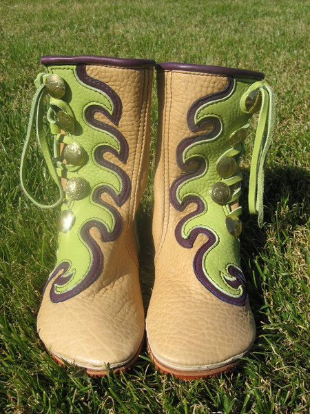 Whooohoooo!  Boots that are having a party whether they are on or off your feet!<br /> Mimi designed her boots with COLOR in mind - lots of it! <br /> Five Button Sand Bullhide, Lime Green Wave Combo Button Trim, Eggplant Purple Underlay, Eggplant Purple Top Welt, QuickSilver Brass Buttons, Conveyor Belt Soling.