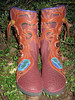 Oh yeh - there is a reason I love my job!  This beautiful pair of tree boots are living in the trees on a beautiful woman's feet!  Yeh!  And she has the whole world at her feet!<br /> Redwood Buffalo five button moccasins; Tobacco Button Trim in a tree design with the branches going around the leg, black underlay on branches, and the Earth nestled in the roots of the tree; Purple Deerskin Full Welt with curve to the side; Thin Cushi Midsole, Spikeless Golf Vibram Soling.  My oh my...