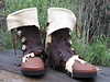 Virginia is a Woodswalker - can you tell?  After losing everything she owned in the fires of 2008, Virginia needed a new pair of boots.  As she lives nearby, and is a shoemaker herself, we worked together on this pair.  Nice, huh?!  Her Five Button Moccasins are Tobacco Buffalo, with Chocolate Natural Edge Button Trim, a Natural Edge Palomino Deerskin Underlay, (both left loose and hangy), a Top Flap of Palomino Deerskin, Burnt Edge Antler Crowns, Thick Cushi Midsole with Spikeless Golf Vibram Soling.  Wow!  Now she's walking!  By the way, Virginia doesn't like anything to be symetrical - interesting challenge for me!