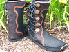 Malama's Cloud Dancing shoes...<br /> Five Button Black Buffalo, Chocolate Buffalo Button Trim, Organic Curve Design, connecting around the top and down the back with the Tabs and Heel, Burnt Cork Deerskin Underlay, Natural Top Edge, Medium/Dark Antler Crowns, SuperFlex Soling.