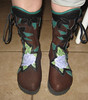 Sue's beautiful boots replicate the image of her tattoo - a beautiful rose.  The rose is tooled and dyed by the wonderful folks at Paradise Beads and Leather.<br /> Sue chose chocolate buffalo hide, black button trim in a leaf design, with green leaves peeking out.  She has a full welt finished in green deerskin.  Her boots are soled with thick cushi midsole and spikeless golf vibram soling.