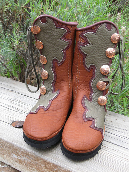 Five button tobacco buffalo boots, olive bullhide button trim in the lotus flower design, with a redwood deerskin underlay and full welt.  Copper Quicksilver Mint buttons, thin cushi midsole, and Gumlite Vibram soling.