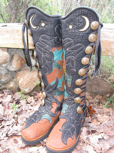Fantastic Fairy Boots, for a magical fairy woman.  Tobacco buffalo boots, with black buffalo button trim in Cassidy's Leaf design.  Underlay of Cassidy's Leaves in various tones of green and black deerskin.  Crescent Moon and star in creme.  The heels area also embroidered with Cassidy's leaf design.  Quicksilver Mint Buttons in brass, with a full welt in black deerskin.