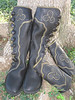 Tuesday's Fairy Prince is Michael, and he is a creative soul.  He designed these beautiful boots with matching bracers so that he can be ready to accompany his princess in style.  Michael's boots are made from black buffalo hide.  The points and curves button trim is made from Michael's moose hide - the product of his hunting trip!  The olive underlay is a special tan cowhide, and the triskellion applique is deerskin.  Michael added the full welt in olive, with the curve being very slight and 'to the side'.  The buttons are black antler crowns, and the soling is the thick cushi midsole with the Kletterlift Vibram with a heel.  The matching bracer's (arm protectors) are made from his moose hide with the olive cowhide and deerskin triskellion.  He may need some help from his princess, as they lace up the back.  Many blessings to this beautiful fairy prince and his family.