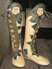 Emmer's Hawaiin dream boots....<br /> Sand Bullhide Nine Button Moccasins, Olive Green Leaf Button Trim, Forest Green Leaf Underlay, Applique Flower in Gold and Creme Deerskin with 3D Stamen, Forest Green Full Welt, Leaf Tabs, Leaf Heel, Antler Crown Buttons and Silver QuickSilver Buttons, Spikeless Golf Vibram Soling.