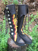 "Pirate Boots: Black Buffalo, Black Points and Curves Button Trim, Red Deerskin Points and Curves Underlay, Gold Deerskin Natural Edge Raggy Ruffle Underlay, Natural Edge Deerskin Flap, Silver Death's Head QuickSilver Buttons ( <a href=""http://www.quicksilvermint.com/gallery"">http://www.quicksilvermint.com/gallery</a>)<br /> Cushi Midsole, Spikeless Golf Vibram Soling"