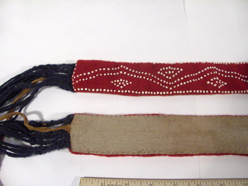 Back view of leg ties, showing linen backing and hand stitching.  These are currently the property of History for Hire, inc., props.