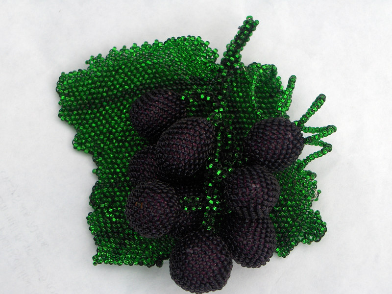 These peyote stitch grapes are part of a long term commission for a full size Carmen Miranda hat, made entirely of beaded fruit.