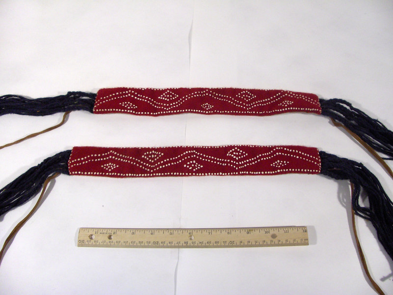 "These are recreated leg ties used by Northeastern Indians, and subsequently American trappers in the 18th century. This particular set were made using ""puff paint"" on wool for film purposes."