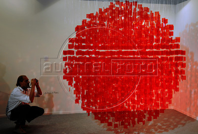 People look at a art piece by Argentinian artist Julio Le Parc on exhibit at ArtRio, International Contemporary Art Fair of Rio de Janeiro, Rio de Janeiro, Brazil, September 12, 2012. (Austral Foto/Renzo Gostoli)