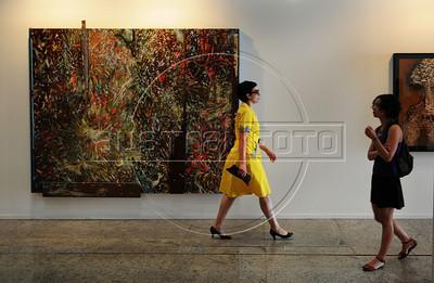 People past by art pieces on exhibit at ArtRio, International Contemporary Art Fair of Rio de Janeiro, Rio de Janeiro, Brazil, September 12, 2012. (Austral Foto/Renzo Gostoli)